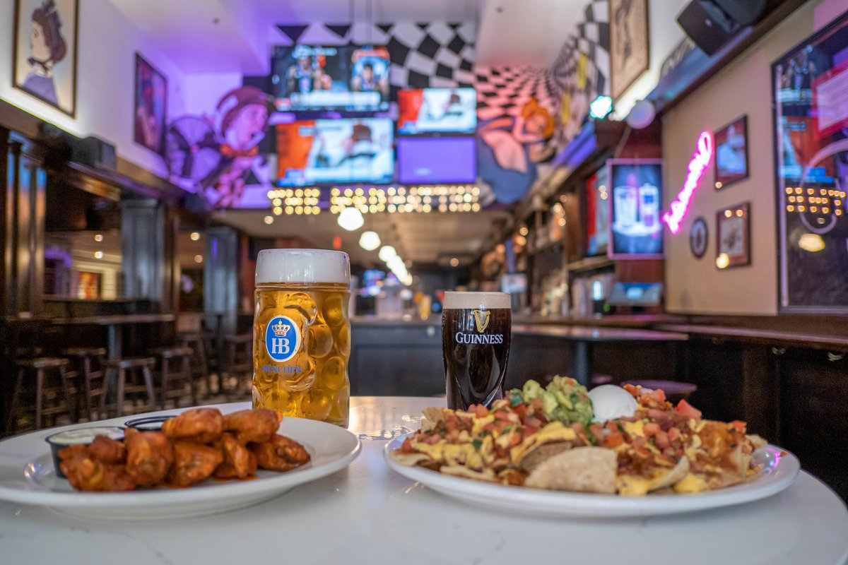 pints-and-plates-of-food-at-madhatter-restaurant