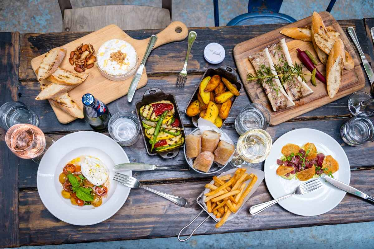 plates-of-food-on-table-of-pardon-my-french-restaurant