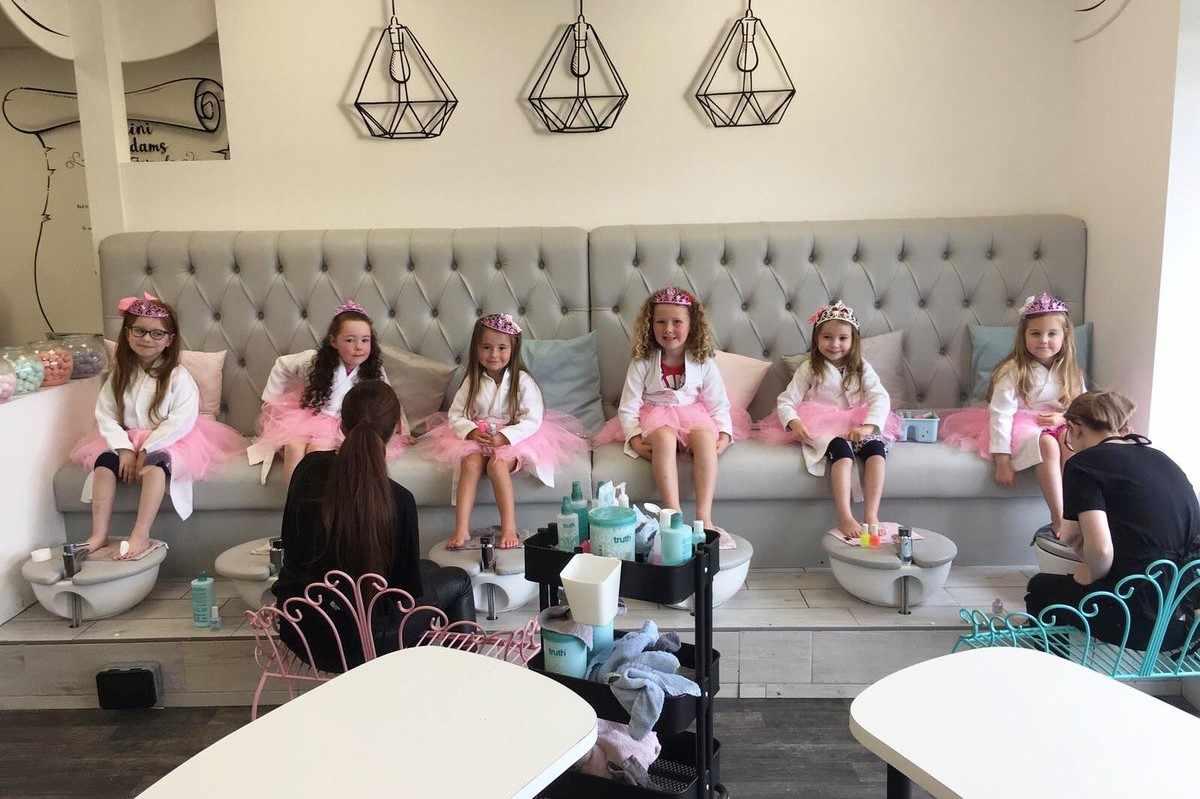 young-girls-having-their-nails-done-at-mini-madams
