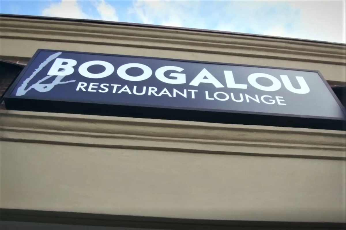 boogalou-restaurant-and-lounge-sign-on-sunny-day