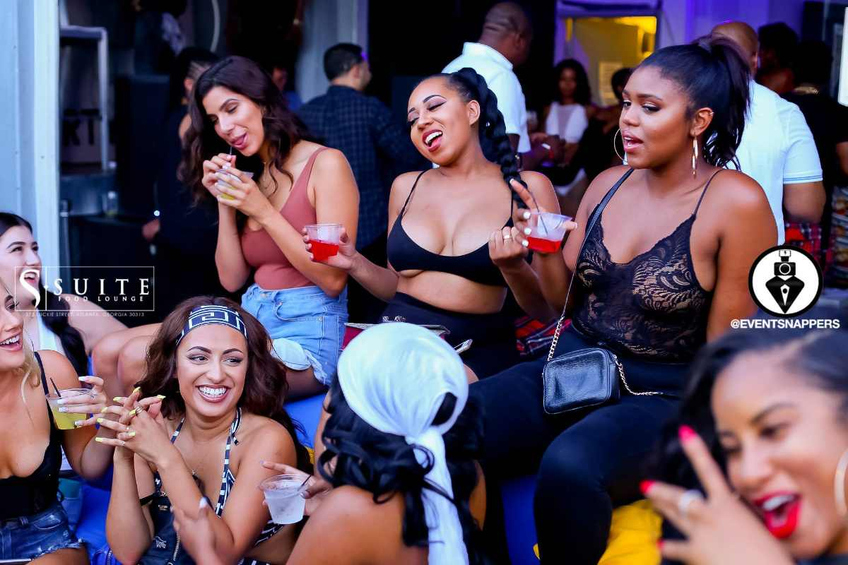 group-of-friends-drinking-at-suite-food-lounge