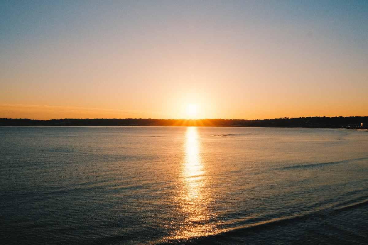 sunset-across-ocean-by-beach