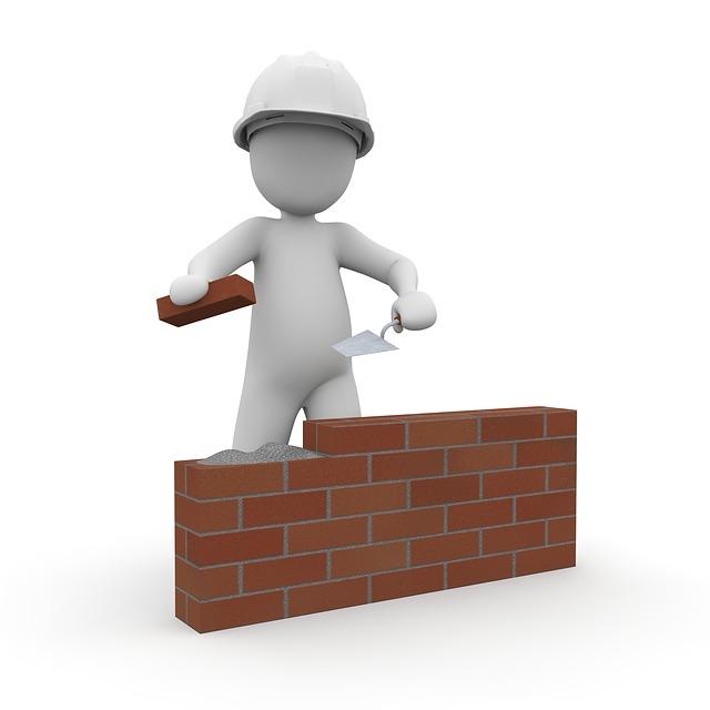 Pupazzo muratore che costruisce un muretto