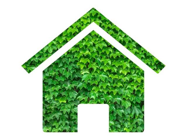 immagine stilizzata di una casa green fatta di foglie verdi