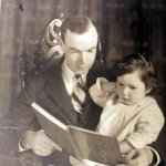 Reading with her father