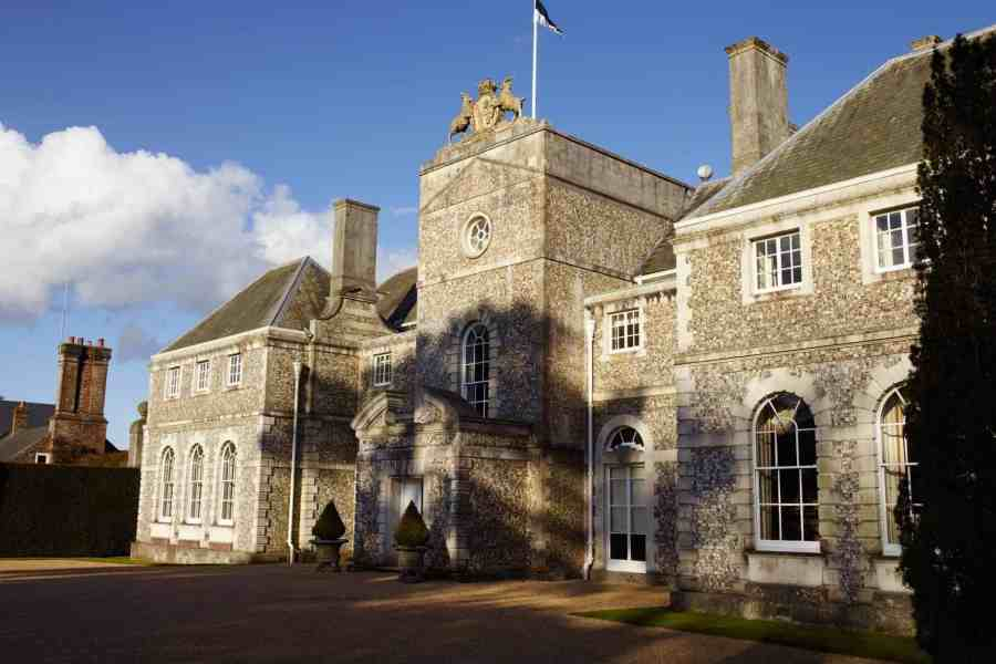 Farleigh House front facade with flag flying