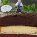 O007 - Wallace augering the World Soil Day cake to check out the depth of the chocolate horizon