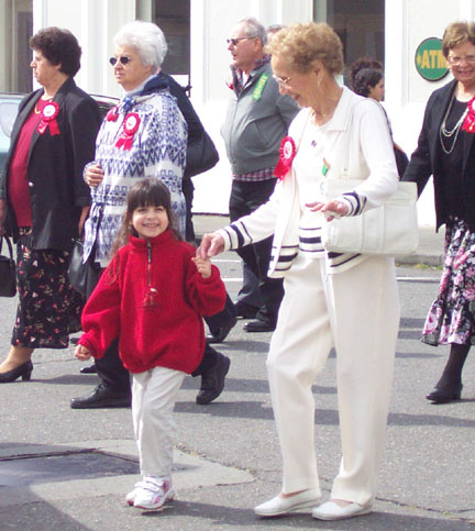Great Grandma & Great Grand Daughter walking in the Holy Ghost Parade - 2005