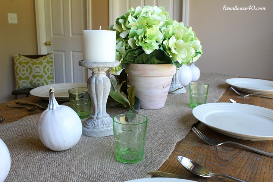 white candles holders and pumpkins