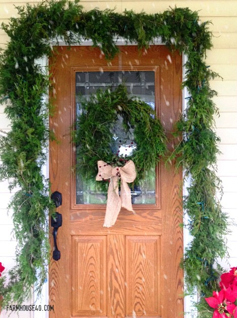 cedar garland around door with snowfall