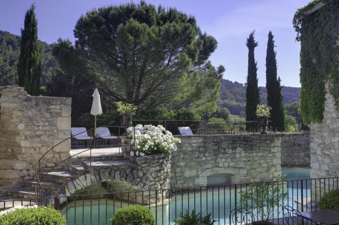 Swimming Pool at La Bastide de Marie, a luxury vineyard hotel & restaurant near Menerbes & Gordes, Provence, France.