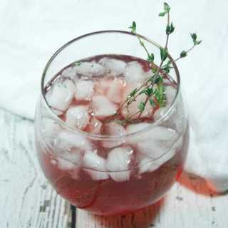 This Cranberry Thyme Spritzer has all the characteristics of a festive holiday cocktail. It's bubbly, red, & cranberry-ish but also Whole30-compliant!
