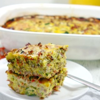 This Paleo and Whole30 Breakfast Casserole will be the hit of your weekend brunch. Filled with bacon, eggs and beef, it even sneaks in loads of healthy veggies!