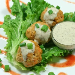 These Paleo and Whole30 Buffalo Chicken Meatballs are the perfect combo of spice + tang + meaty deliciousness. Wrap in gorgeous green lettuce leaves & drizzle with Whole30-approved ranch dressing. You'd never know they are good for you!