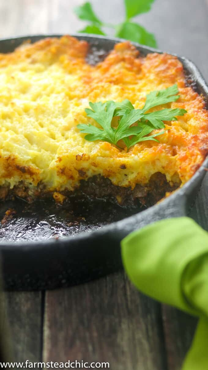 This Whole30 Shepherd's Pie is packed full of savory flavors like thyme and rosemary. Lamb meat is topped with fluffy, buttery mashed potatoes toasted to perfection under the broiler. Dairy free and gluten free. Use ground beef for a Whole30 Cottage Pie instead.