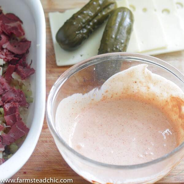 Low Carb, Keto Reuben Casserole with Swiss cheese, homemade Russian dressing and pickles