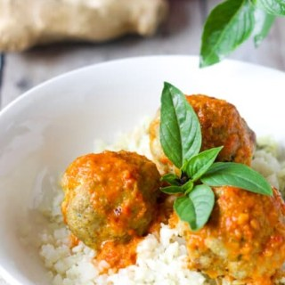 Low Carb, Keto Curry Turkey Meatballs served over cauliflower rice and topped with red curry sauce and fresh Thai basil