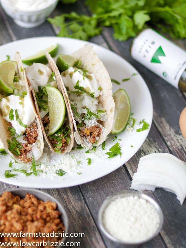 low carb keto chorizo breakfast tacos with cotija cheese, sour cream and cilantro