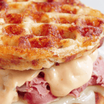 The perfect Chaffle bread, shaved corn beef, juicy sauerkraut, crunchy dill pickles, melty Swiss cheese and Thousand Island dressing make this Keto Reuben Chaffle taste better than the real thing without all the harmful additives and questionable ingredients.  #ketoreuben #reubenchaffle #lowcarbreuben #lowcarbsandwich #chaffle #farmsteadchic