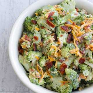 This Low Carb, Keto Broccoli Salad is made with fresh, raw broccoli, crispy fried bacon, shredded cheddar and creamy mayonnaise. It's a great fresh and crunchy addition to your holiday potluck or summer BBQ. | www.farmsteadchic.com | #ketobroccolisalad #lowcarbbroccolisalad #farmsteadchic #ketoholiday #lowcarbholiday #ketoBBQ #lowcarbBBQ #broccolisalad