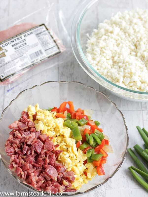 With this Low Carb, Keto Ham Fried Rice (Fried Cauliflower Rice), you can have your takeout and stay low carb too! Freshly riced cauliflower replaces traditional rice, and bell peppers add sweet and savory flavors plus crunch without all the carbs the usual takeout fried rice veggies have. Freshly grated ginger and minced garlic take the whole dish to the next level.  #farmsteadchic #CliftyFarm #countryham #southerncooking #ketofriedrice #lowcarbfriedrice #hamfriedrice