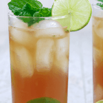 This Low Carb, Keto Spiced Rum Mojito is a sugar-free, snappy take on the traditional Cuban cocktail. While a regular mojito can add up to 50 carbs (or more), this Keto Mojito is less than two carbs! You can't go wrong with dark spiced rum, tangy lime juice and fresh mint leaves. | www.farmsteadchic.com | #ketococktail #lowcarbcocktail #mojito #ketomojito #lowcarbmojito #farmsteadchic #darkrummojito #spicedrummojito