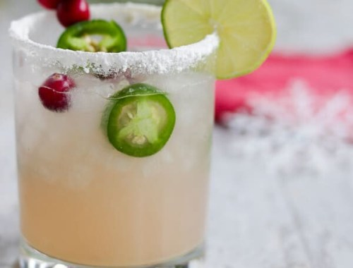 This Low Carb, Keto Spicy Cranberry Margarita is the perfect guilt-free holiday cocktail! Fresh cranberries and jalapeños add a special twist to the traditional margarita. Orange extract and a little water replace the traditional sugar-laden orange liqueur.  www.farmsteadchic.com #ketococktail #lowcarbcocktail #ketomargarita #lowcarbmargarita #spicymargarita #holidaymargarita #Christmascocktail