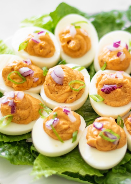 These Korean kimchi keto deviled eggs are a spicy and flavorful twist on traditional deviled eggs. Made with only four ingredients (plus S&P), they a super simple, naturally low carb and keto-friendly appetizer or snack.