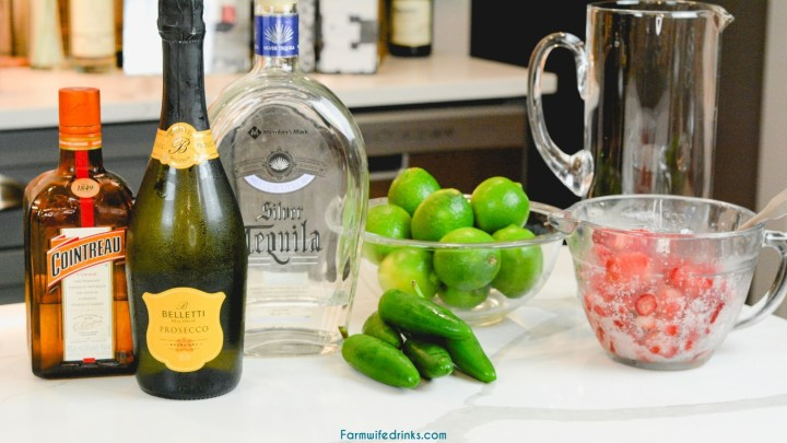Champagne Margarita Ingredients - Tequila, champagne, cointreau, strawberries, limes, and jalapeños.