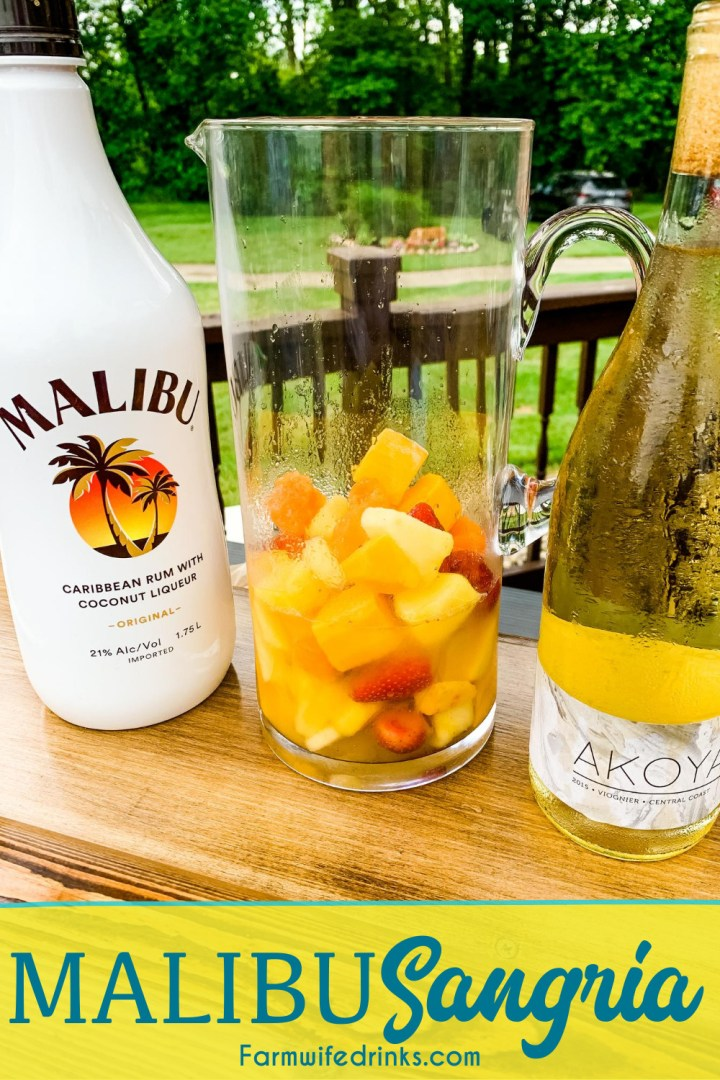 Malibu sangria recipe is a simple and perfect tropical drink for a summer day pool cocktail made with white wine, Malibu Rum, pineapple juice, and tropical frozen fruit like pineapple and mangos.