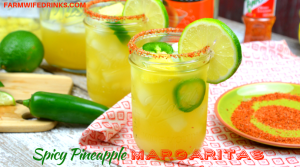 Spicy Pineapple Margaritas by the Pitcher combine the sweet nectar of pineapple infused tequila with triple sec, pineapple and lime juices and a kick of jalapeno heat. Add Tajin seasoning to add a smoky heat to the salted rim. #pineapplemargarita #Margarita #Tequila