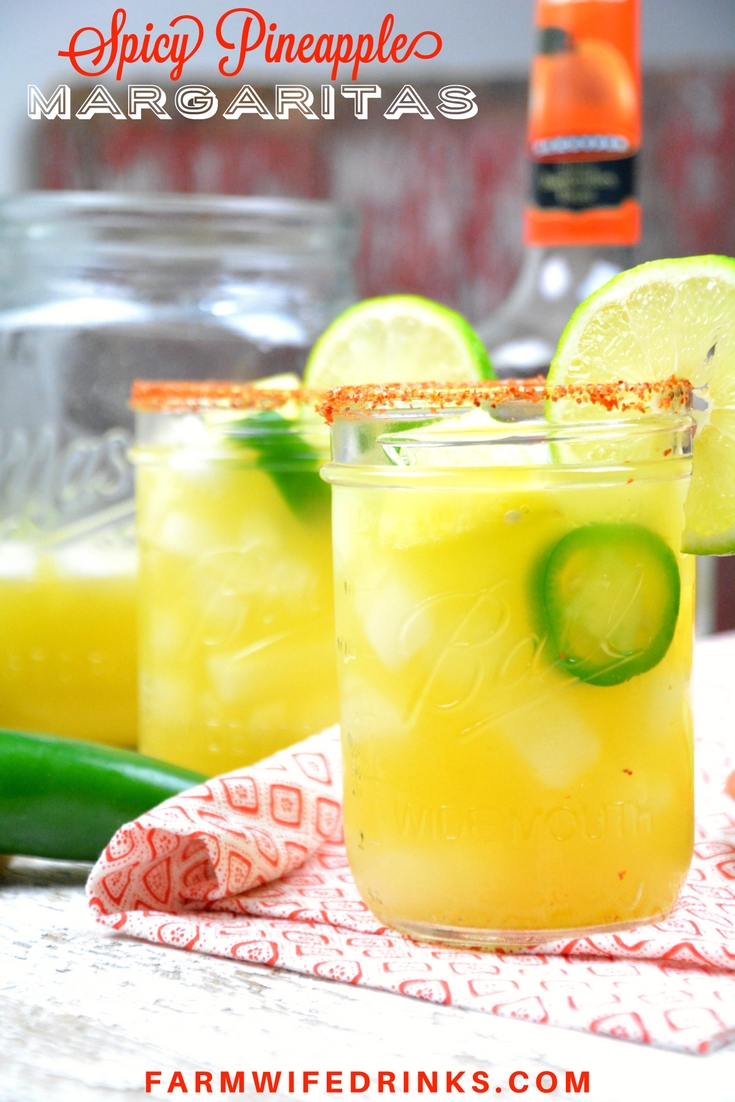 Spicy Pineapple Margaritas by the Pitcher combine the sweet nectar of pineapple infused tequila with triple sec, pineapple and lime juices and a kick of jalapeno heat. Add Tajin seasoning to add a smoky heat to the salted rim.