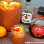 Amaretto Bourbon Punch recipe is maraschino cherries combined with limeade and orange juice with a whole lot of bourbon and just enough Amaretto. #Bourbon #Whiskey #Amaretto #Cocktails