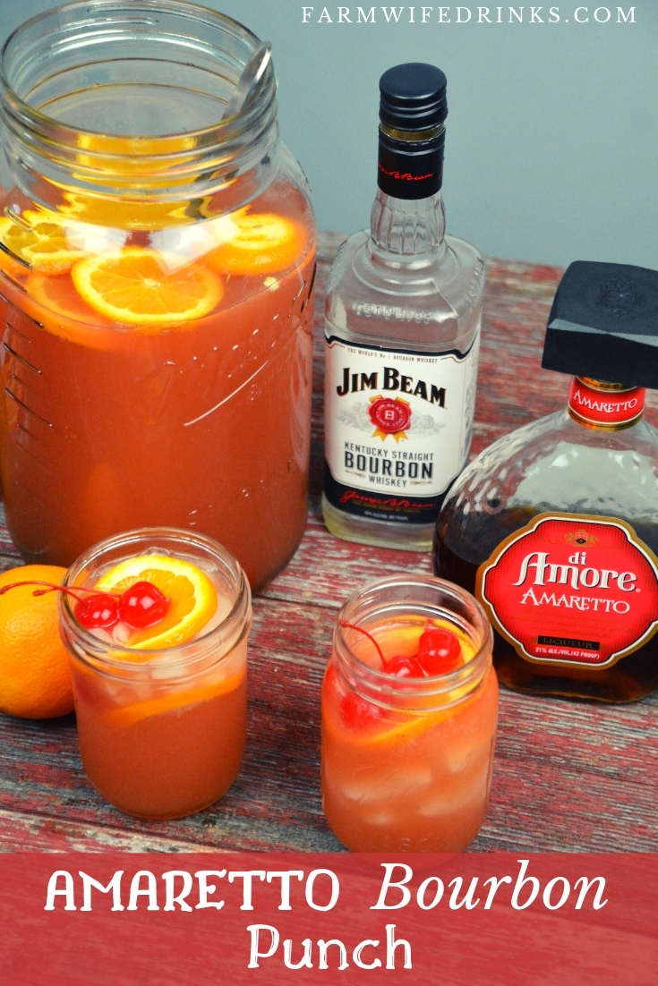Amaretto Bourbon Punch recipe is maraschino cherries combined with limeade and orange juice with a whole lot of bourbon and just enough Amaretto. #Bourbon #Amaretto #Cocktails #Whiskey