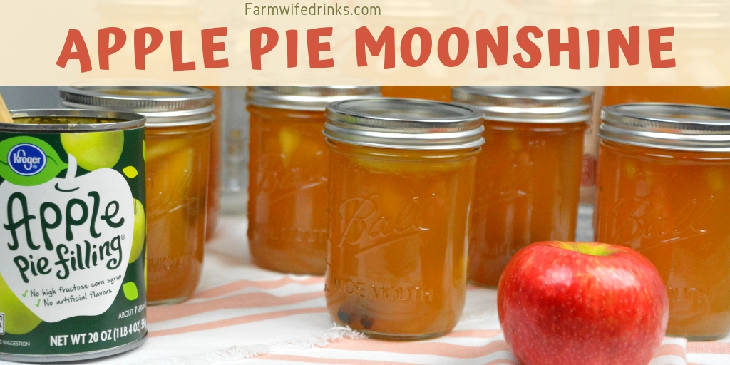 Apple pie moonshine combines apple pie filling with cinnamon sticks and vanilla with moonshine and vanilla vodka to create your new favorite fall liquor to drink. #Moonshine #AppleRecipes #ApplePie #Vodka