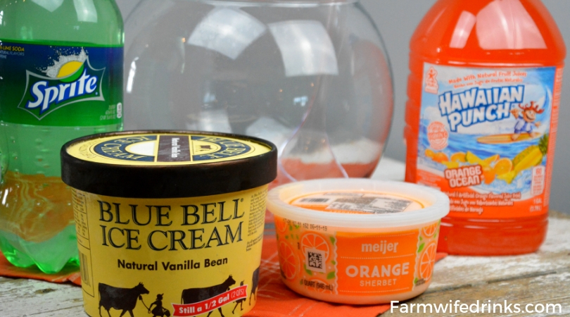 The sweet combination of orange sherbet, vanilla ice cream with orange Hawaiian Punch and a bit of Sprite to give it a little fizz to create this fun creamy orange sherbet punch. #Sherbet #PunchRecipes #OrangeFood #OrangeTheme #Halloween