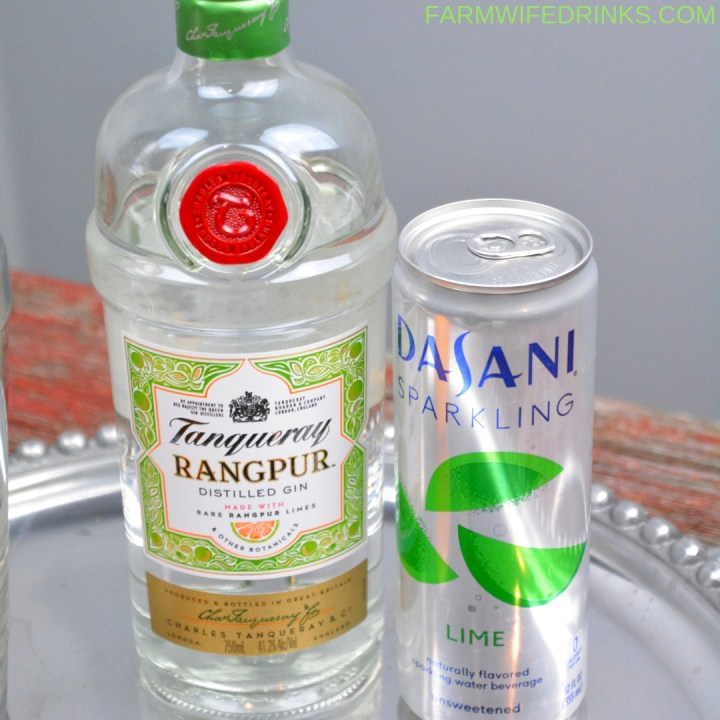 Orange Lime Gin Fizz is a low-carb gin cocktail combining freshly squeezed lime and orange juices with Rangpur gin and lime sparkling water. #Gin #GinFizz #Tanqueray #Cocktail #Cocktails