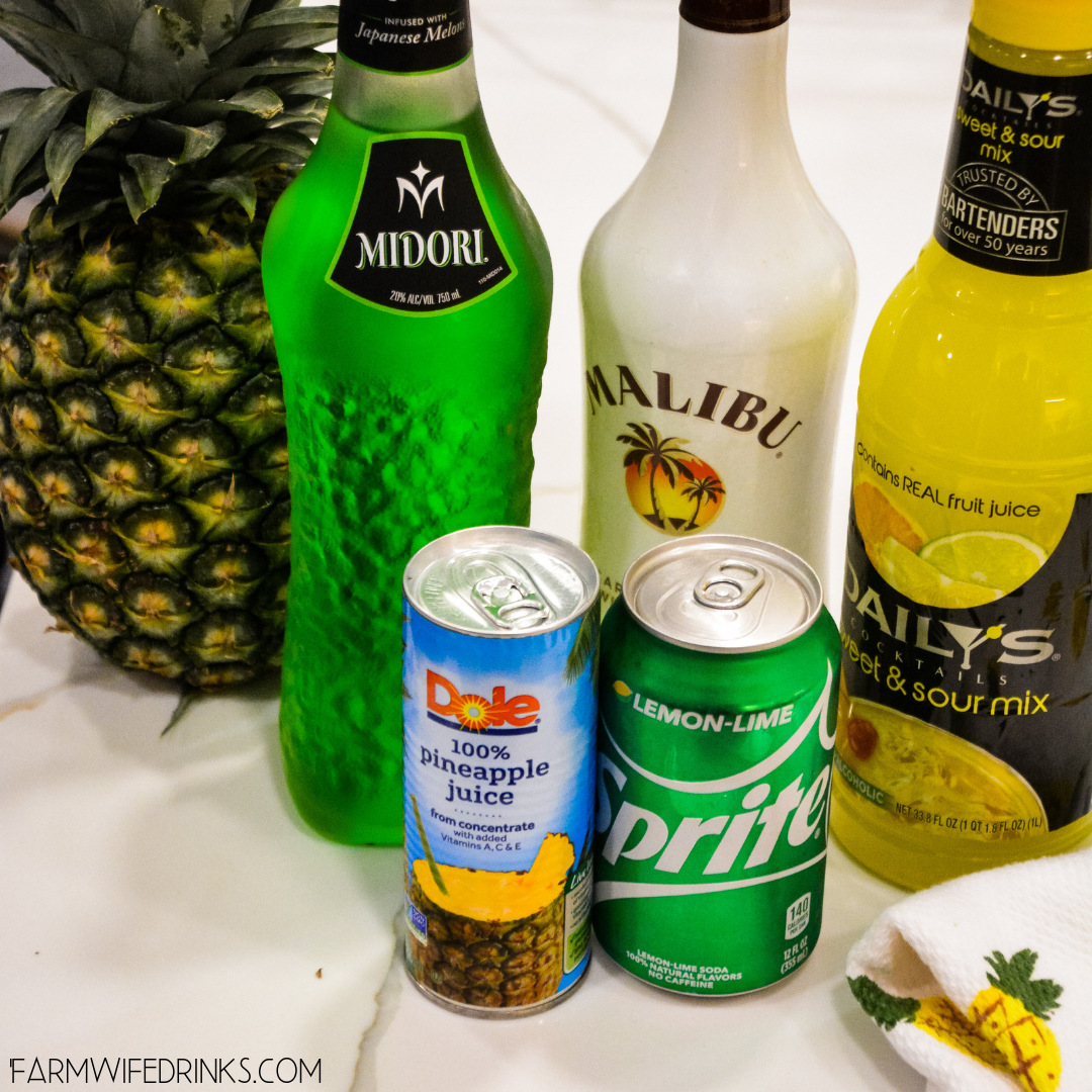 Green Hawaiian Cocktail combines all the tropical flavors of pineapple, melon, coconut, and citrus with Midori, Malibu Rum, pineapple juice, and lemon-lime soda for the best beach or pool cocktail.