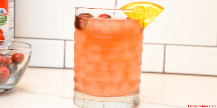 Orange cranberry vodka cocktail is the combination of cranberry and orange juice along with mandarin and raspberry vodkas for a crisp refreshing Christmas Eve cocktail.