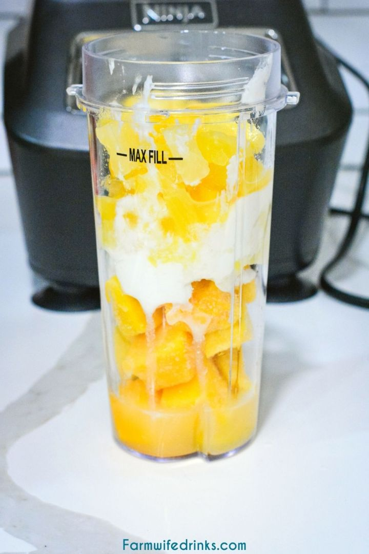 Mango Magic Smoothie is the current smoothie obsession by my swimmer that is made as a copycat to the Tropical Smoothie Cafe smoothie with just three simple ingredients of mango, pineapple, and greek yogurt.