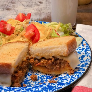Super Easy Italian Sloppy Joes from Farmwife Feeds served on your favorite ready to go garlic bread and a side salad is a go to meal for busy days. #sloppyjoes #Italian #recipe #sandwich