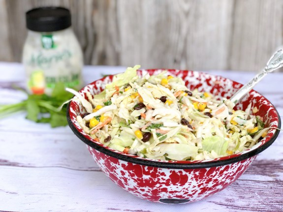Cilantro Cole Slaw from Farmwife Feeds, a fresh easy twist on traditional slaw that's easy to throw together. #recipe #slaw #cilantro