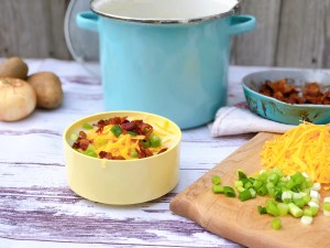 Mom's Creamy Potato Soup from Farmwife Feeds is just a few simple wholesome ingredients that you can then load up with toppings to your liking. #soup #potatoes #potato #recipe