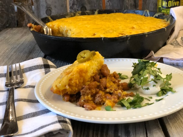 Ranch Beans, Beef and Cornbread Casserole from Farmwife Feeds is a one pan meal full of ground beef, seasoned beans and as much jalapeno kick as you want! #casserole #onepanmeal #groundbeef #castironskillet