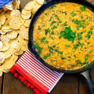 Taco Chili Cheese Dip from Farmwife Feeds makes a great appetizer or meal, is stovetop, oven and crockpot friendly. #dip #crockpot #cheese