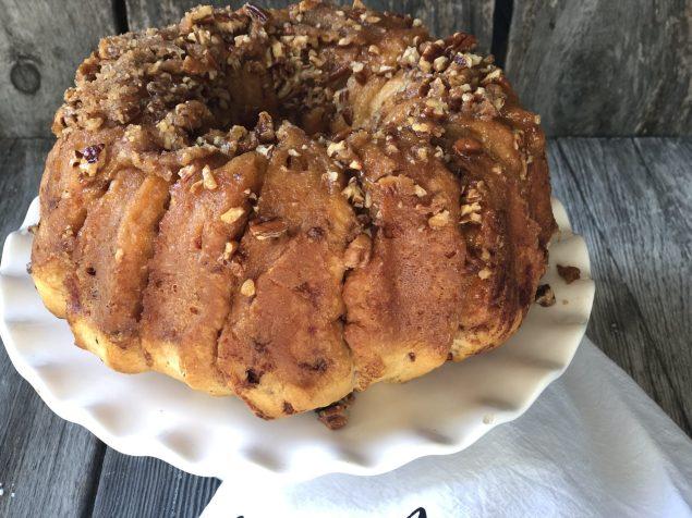 Easy Caramel Cinnamon Roll Bundt Cake from Farmwife Feeds makes a pop can of cinnamon rolls into a delicious easy bundt cake with a caramel glaze and pecans. #cinnamonrolls #bundtcake #easybreakfast