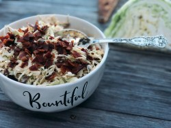 Smoky Bacon Slaw from Farmwife Feeds cabbage with smoky seasonings and crumbled bacon for the win. #slaw #cabbage #bacon