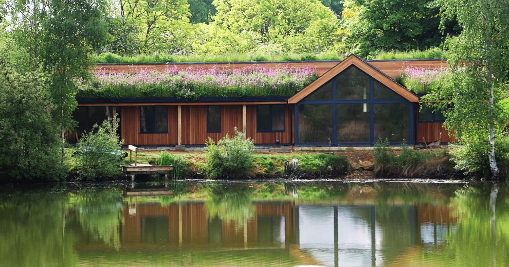 A living roof on a building by a lake
