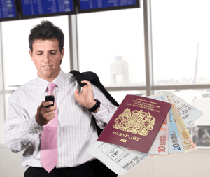 Road Warrior in Airport with Phone with Passport and Money
