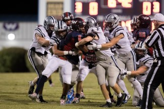 A fleet of Admirals tackle the West running back on 10/7. PHOTO CREDIT: Ashley Wathen, CRFOTO.com